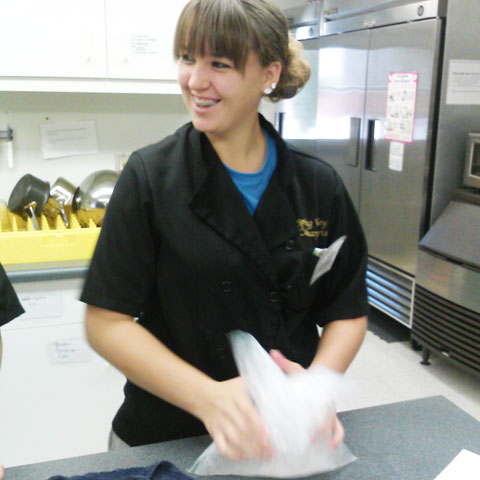 A high school student makes ice cream in a science lab.