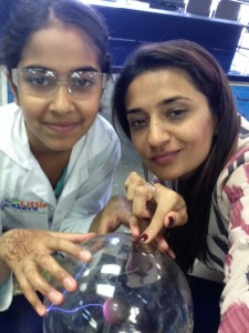 Maliha and her daughter playing with one of their favorite experiments - the plasma ball!