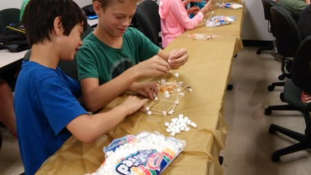 Kid City Science started off with marshmallow/toothpick towers.  The goal:  HEIGHT.
