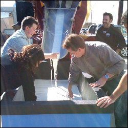 Jeff Brooks, Carly Reed, and Steve Spangler text and mix the cornstarch goo outside The Ellen DeGeneres Show