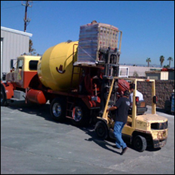 Lifting the cornstarch bags to the top of the cement mixer