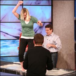 Steve Spangler watches as an audience member dances on the cornstarch goo during the Cornstarch Walk Stunt on The Ellen DeGeneres Show.