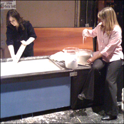 Carly Reed and Renee Spangler mixing cornstarch at The Ellen DeGeneres Show