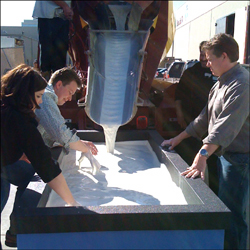 Jeff Brooks, Carly Reed, and Steve Spangler mixing cornstarch goo in the tank before The Ellen DeGeneres Show